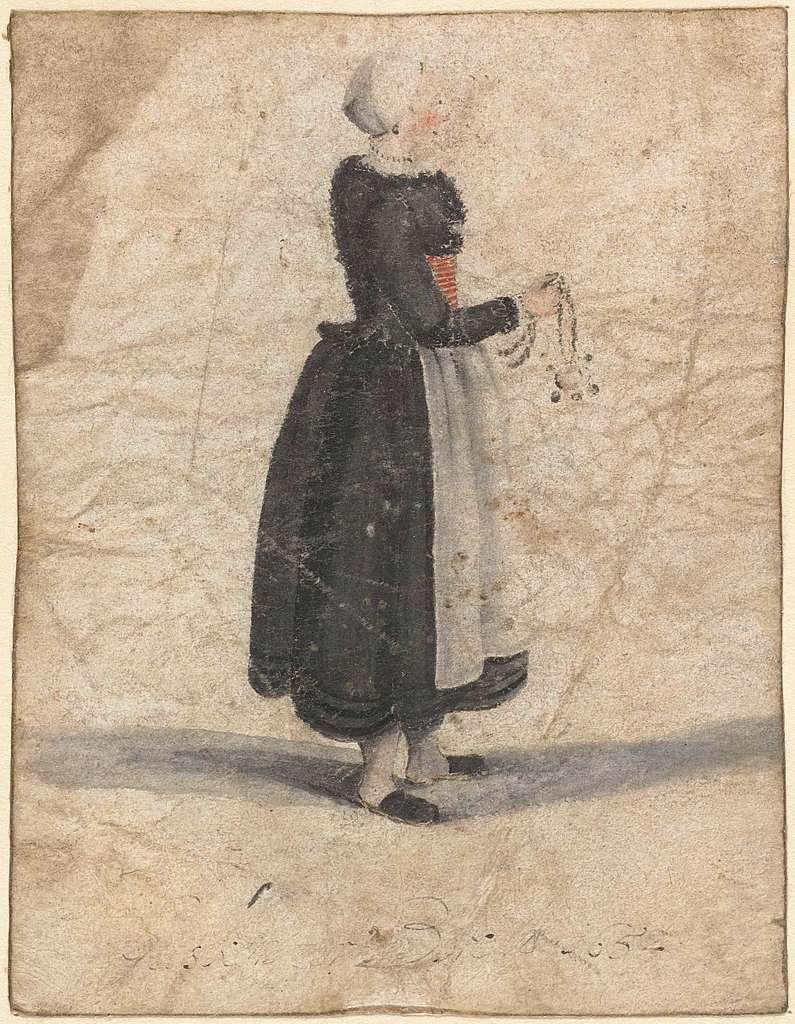 Noord-Hollandse vrouw staand met een ornament of tas in de hand