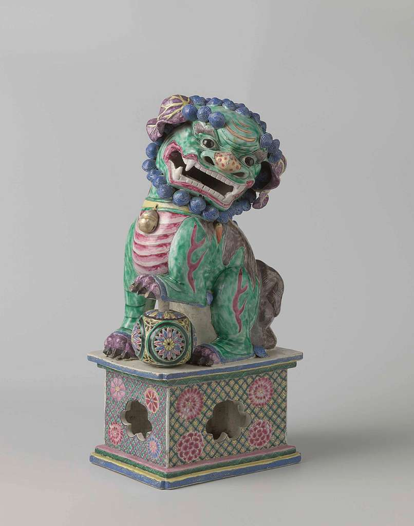 Figure of a shishi with its paw on a pierced ball